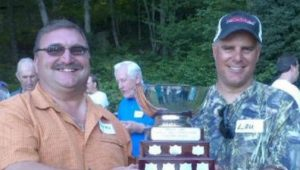 Two men holding the bass fishing trophy