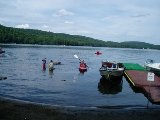 People kayaking to the annual corn roast
