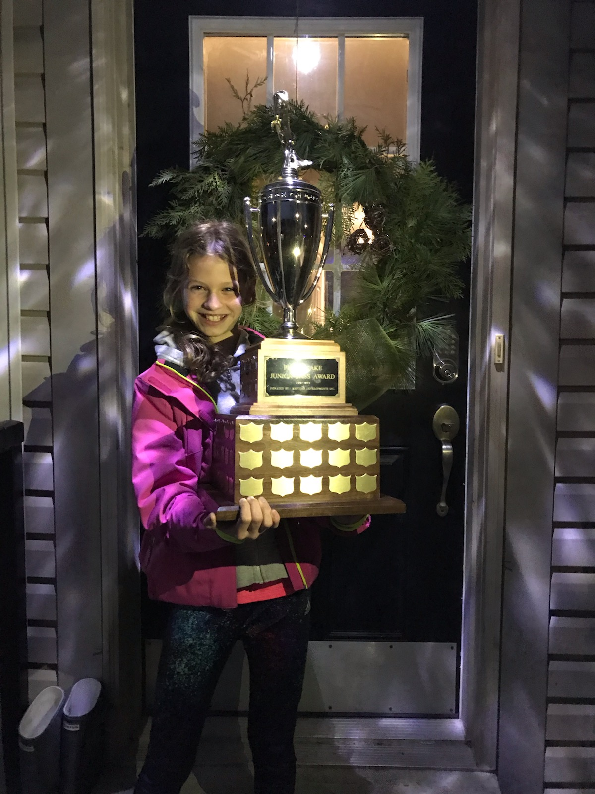 Sophia Edey holding a the youth fishing trophy