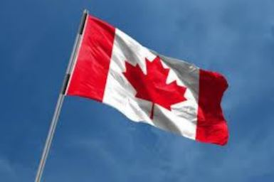 The Canadian flag blowing in the wind.
