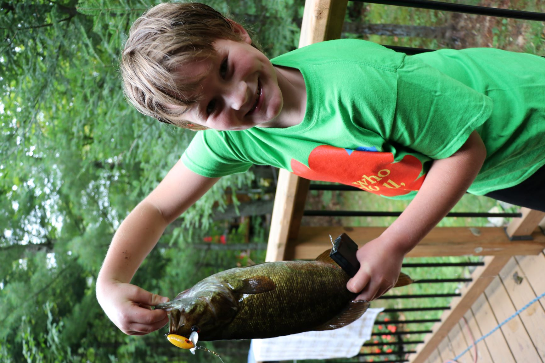 Cohen Elson holding a 18.5 inch smallmouth Bass